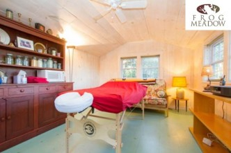 The massage studio has a comfortable and airy feeling and overlooks the orchard