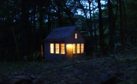 The Brook Cottage glows at night