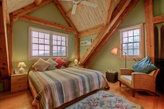 The Main House South Room has a king bed, air conditioning and beautiful views of the Vermont hills,